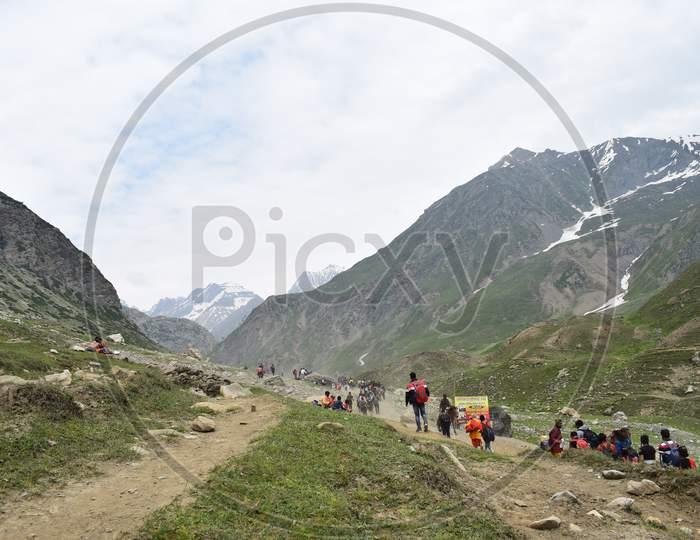 Tourists climbing the hills at Amarnath