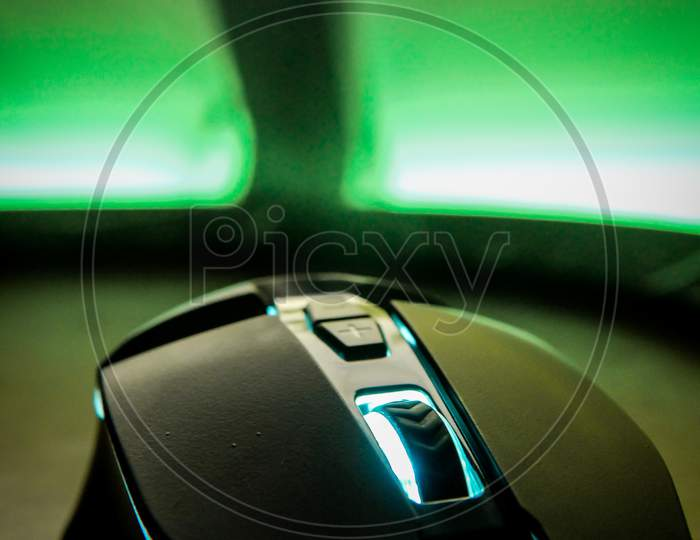 Gaming mouse for desktop, Gaming desktop setup with RGB colors, selective focus on object with blurred background