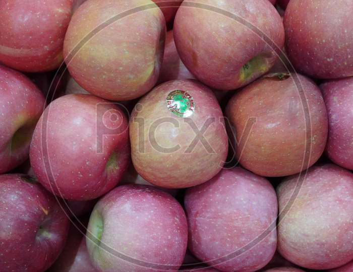 Dubai Uae - November 2019: Bunch Of Pink Apples On Boxes In Supermarket. Apple Put On Sale Shelves In The Supermarket. Fresh Ripe Apples Displayed Beautifully.