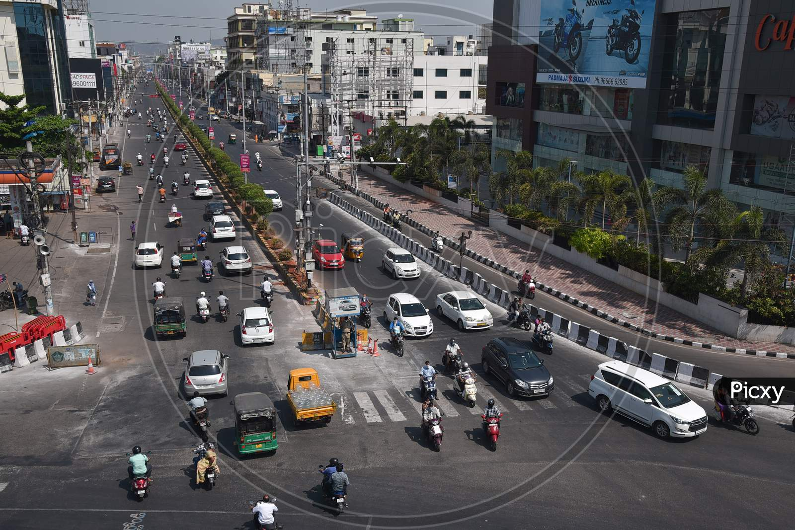 Vehicles Ply At Mg Road, Following The Relaxation Of Restrictions, During The Ongoing Coronavirus Lockdown, In Vijayawada.