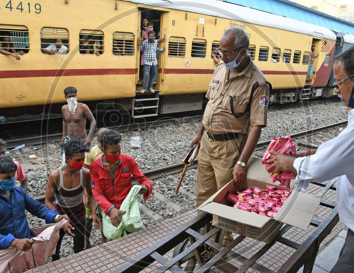 Migrant workers stranded in other states due to lockdown in the emergence of Novel Coronavirus (COVID-19) situation are being given free food by the railway department on their way home.
