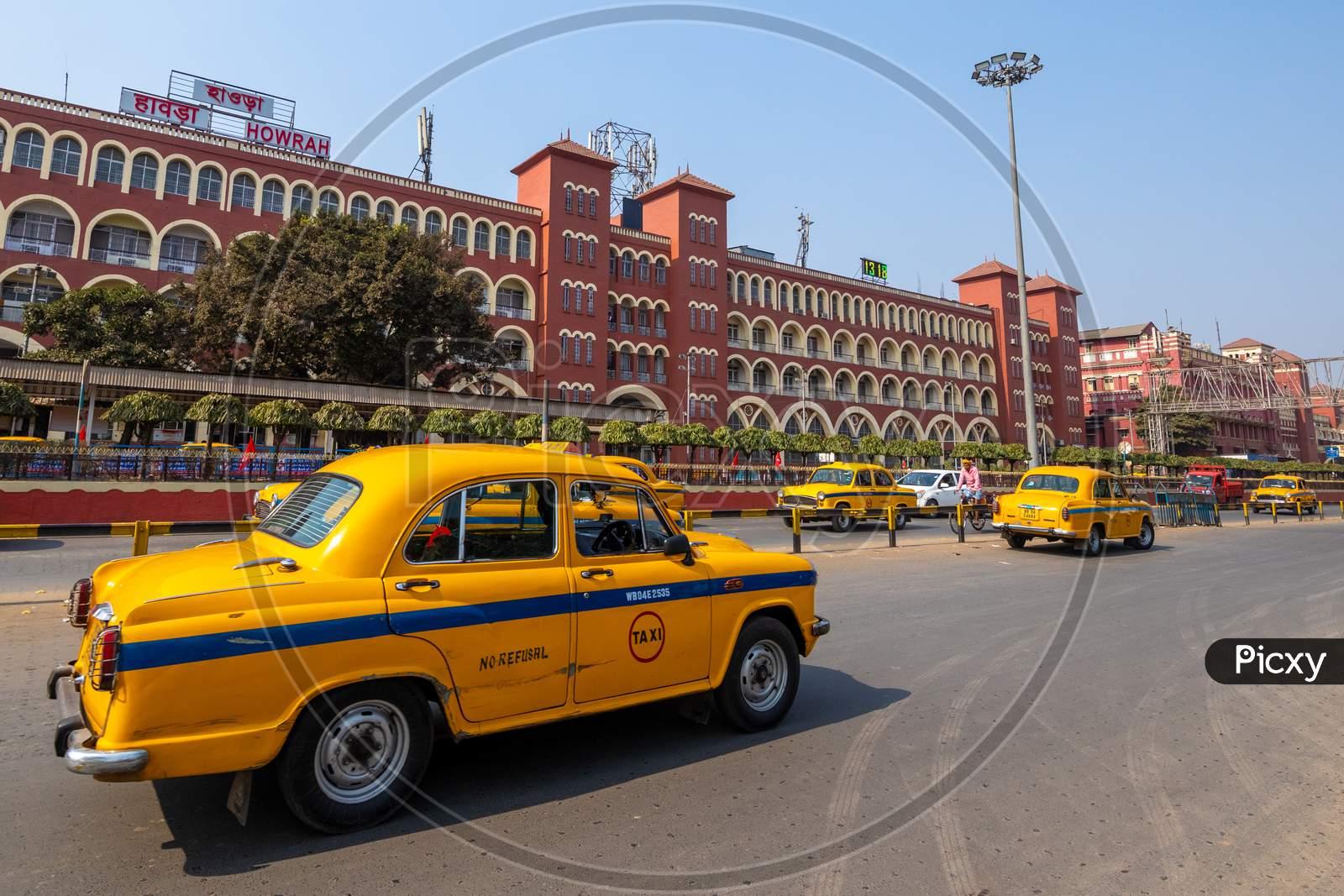 Yellow  Cab  Running On Howrah Railway Station  Background In Kolkata, West Bengal