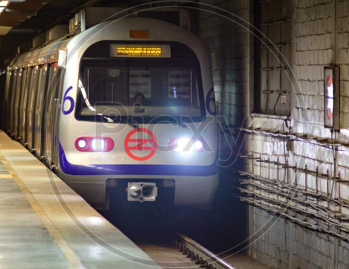 Subway Train Arrives At Metro Station Of Delhi Metro System