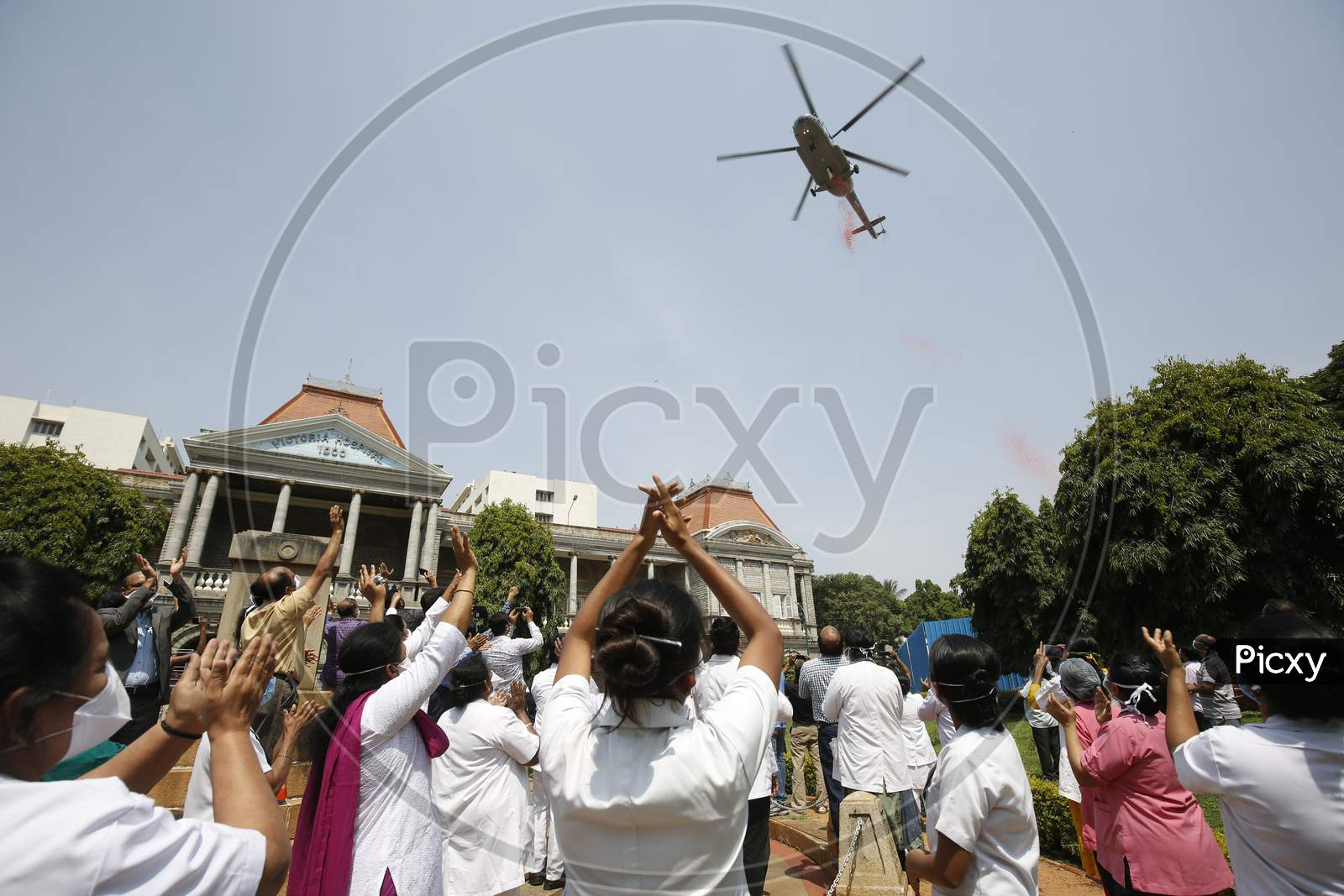 Nurses And Hospital Staff Of Victoria Hospital Cheer As An Indian Air Force (Iaf) Helicopter Showers Flowers On Them During The Nationwide Lockdown To Stop The Spread Of Coronavirus (Covid-19) In Bangalore, India, May 03, 2020.