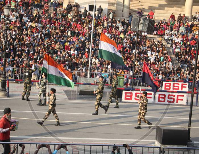 Indian crowd cheering and celebrating Border Security Force of Indian Army at Wagha Border, India. Amritsar, Punjab, India