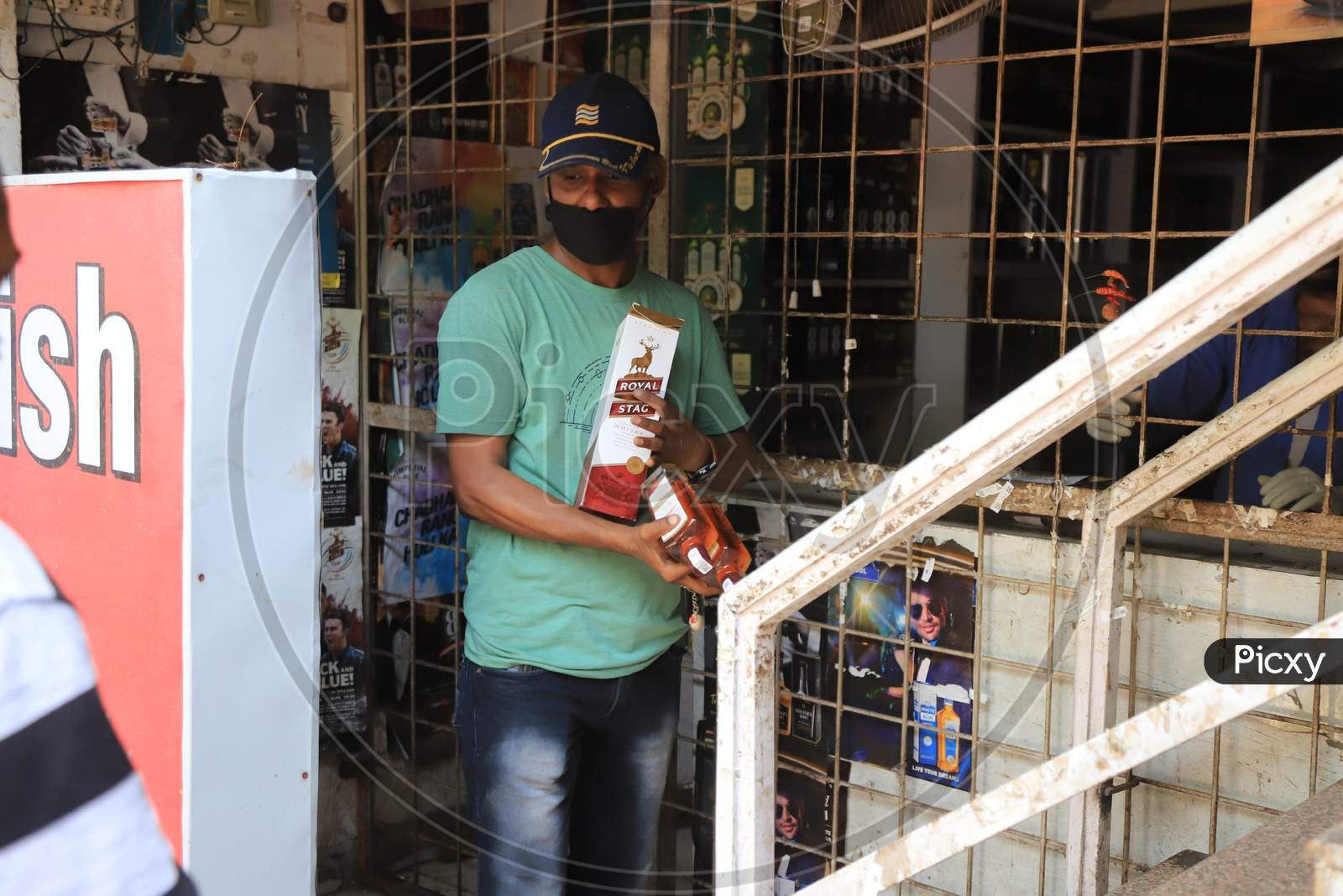 A Man Carrying Liquor Coming Out Of Wine Shop During An Extended Nationwide Lockdown To Slow The Spread Of The Coronavirus Disease Or Covid-19 In Prayagraj, May 4, 2020.