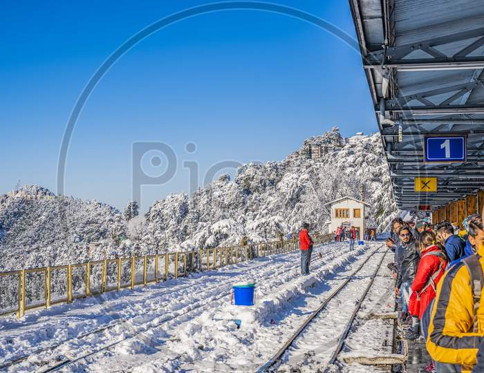 Snowfall View moving train on mountain slopes, beautiful view, one side mountain, one side valley. Toy train from Shimla to Kalka