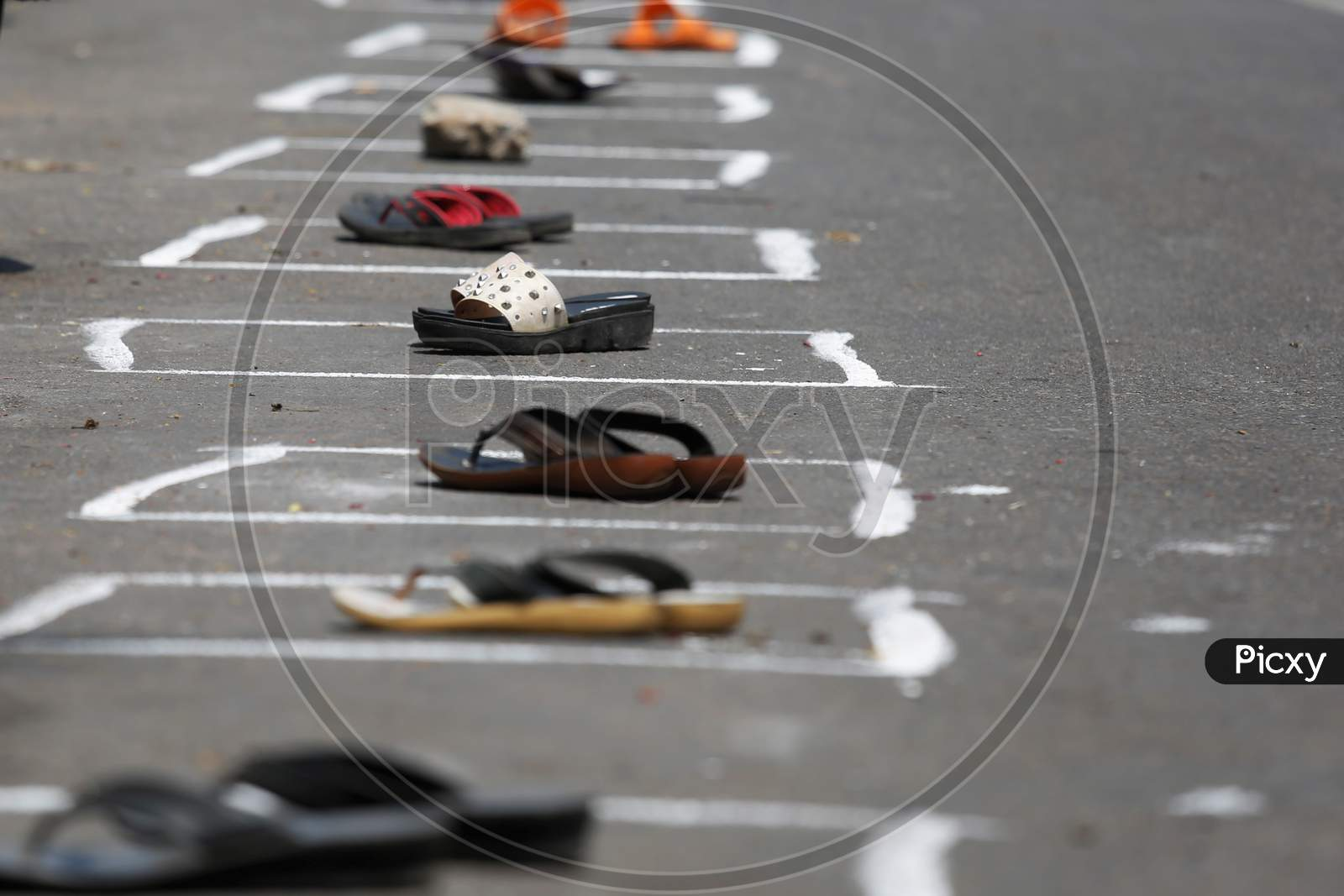 Pairs of slippers are left to secure spots in boxes drawn on a street to maintain social distancing during the nationwide lockdown to stop the spread of Coronavirus (COVID-19) in Bangalore, India, May 02, 2020.