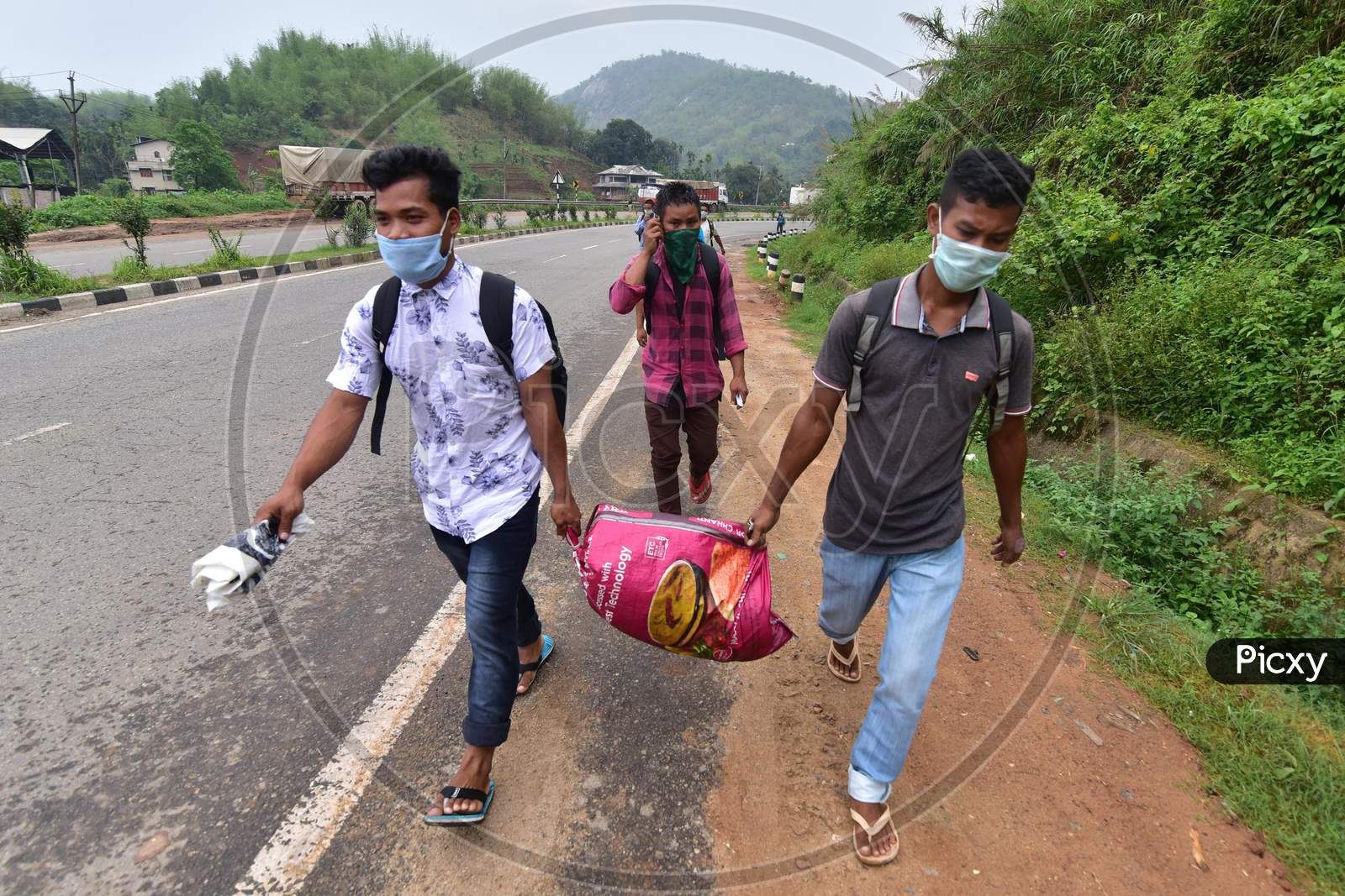 Migrant Workers  Walk Along A Road To Return To Their Villages During Nationwide Lockdown Amidst Coronavirus or COVID-19 Pandemic On The Border Of Assam  And  Meghalaya  In Guwahati,India