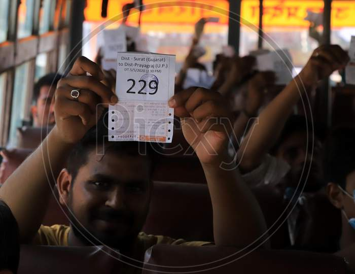 Migrant Workers From Gujarat  Showing Train Ticket After Boarding Buses During Nationwide Lockdown Amidst Coronavirus Or COVID- 19 Pandemic, in Prayagraj, May 6, 2020