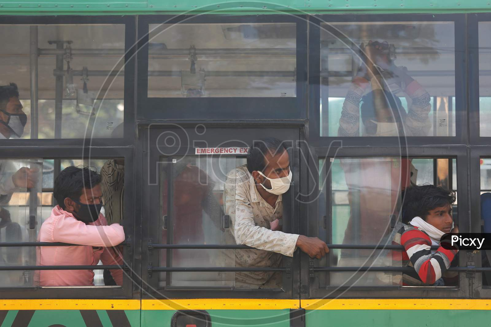 Migrant Workers Sit Inside A Bus As They Wait To Alight To Board A Special Train Arranged By The Government To Repatriate Migrant Workers From The Chikkabanavara Junction Railway Station On The Outskirts Of Bangalore, India.