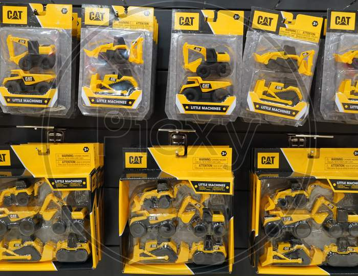 Dubai Uae December 2019 - A Collection Of Cat Excavator And Truck Toys At Toys Store. Toys Hanging In Store For Sale. Cat Brand Toys In A Toy Store.