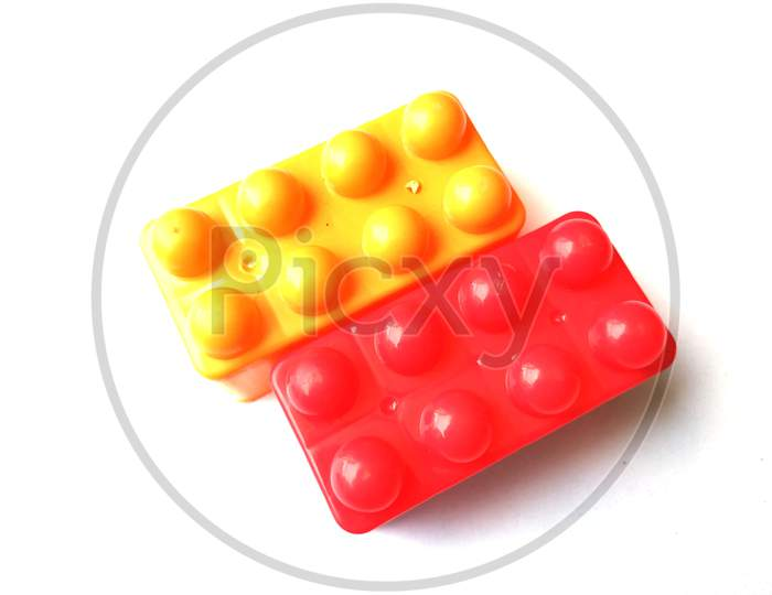 Top view on multi color toy bricks isolated on white  background