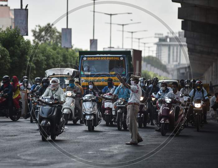 Vehicles ply on a road during the ease of restrictions, in Vijayawada.