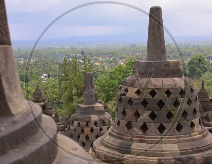 Stupas And Mountains At Borobudur Temple Sunset