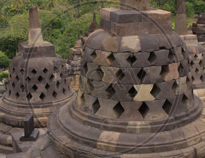Stupas Detail At Borobudur Temple At Cloudy Sunset