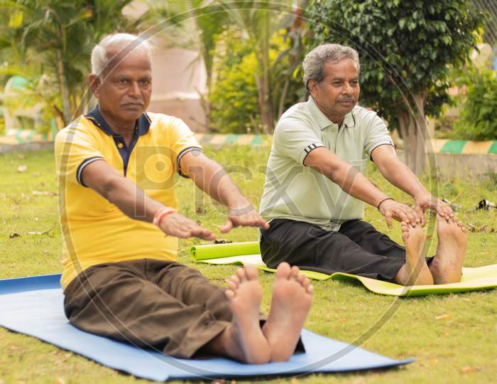 A couple of Elderly Man Or Old Men's Doing Yoga, Fitness Routine At Outdoor