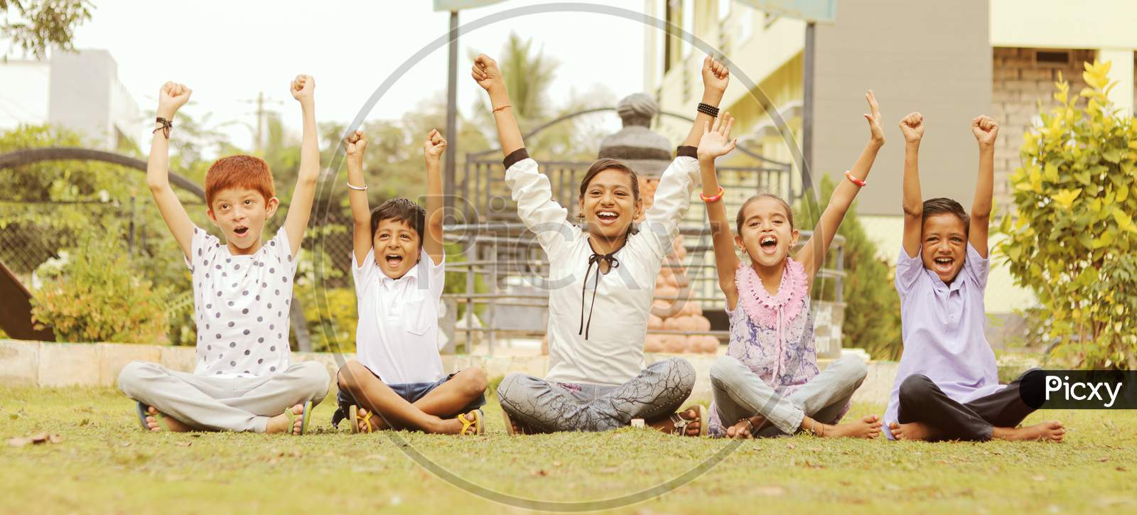 Group Of Young Children Cheering Up At Park - Teens Having Fun During Summer Vacation - Multi Ethnicity Children Playing Joyful By Braking The Racism.