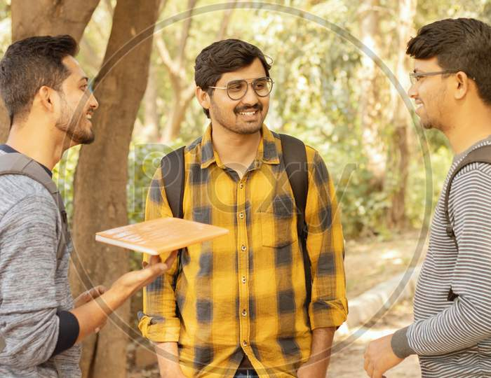 College Friends Socializing - Students Talking With Each Other At University Campus - Concept Of Happy College Days And Student Life.