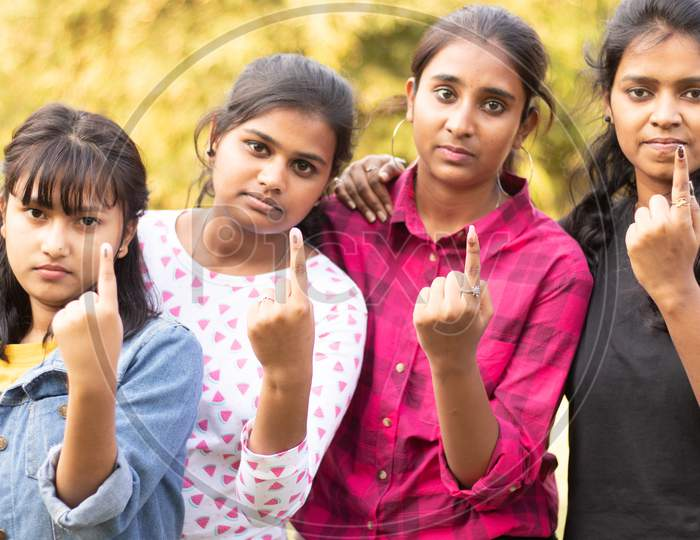 A Group of Young Girls showing their Voted Finger