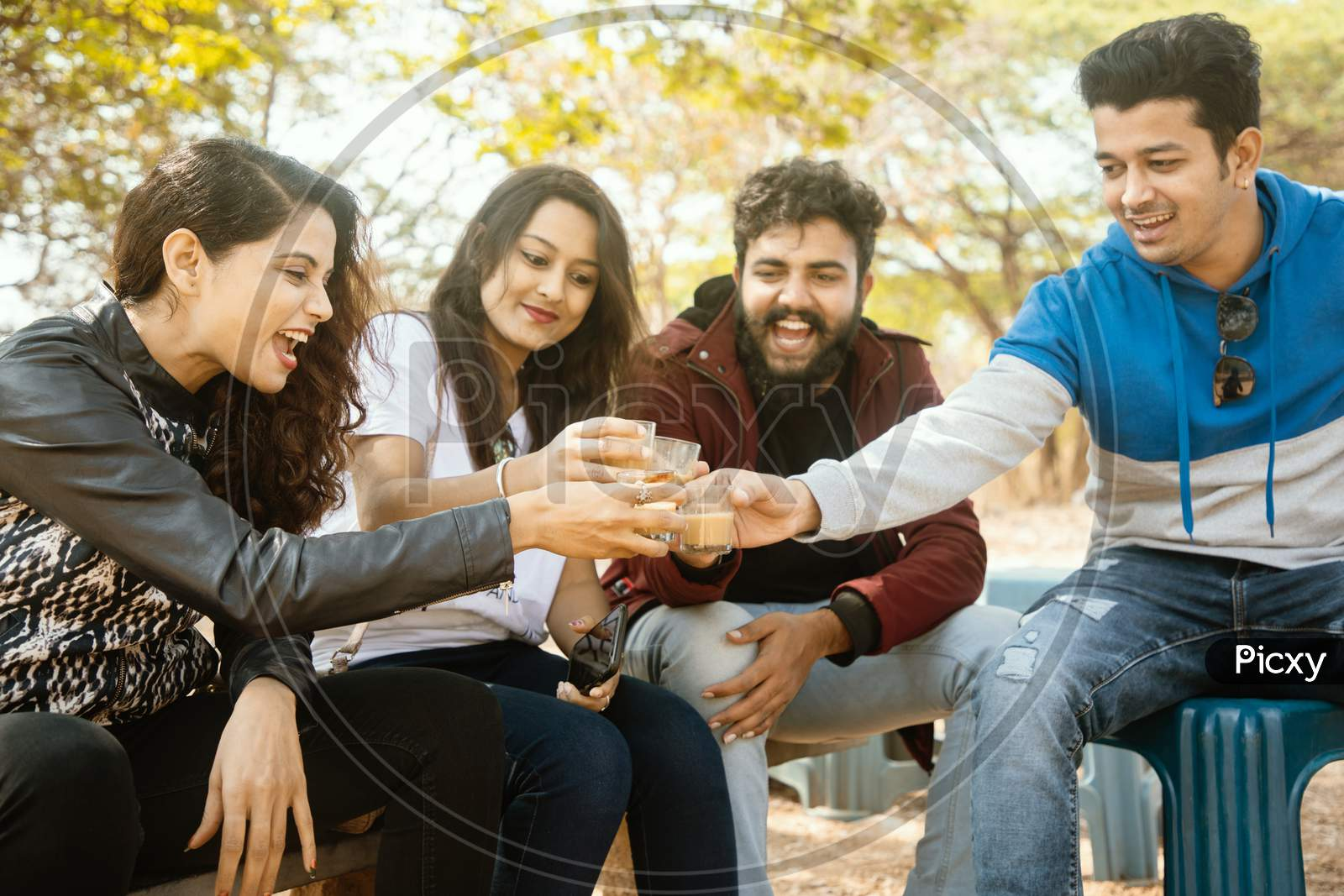 A Group of Happy Young People having Chai or Coffee At Outdoors