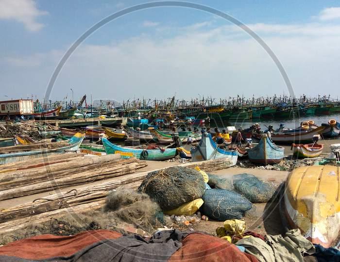 Indian Fishing Boats With Men At Kasimedu Fishing Harbour