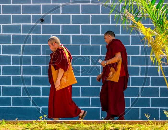 Two Buddhist Monks walking at Bylukoppa in Karnataka/India.