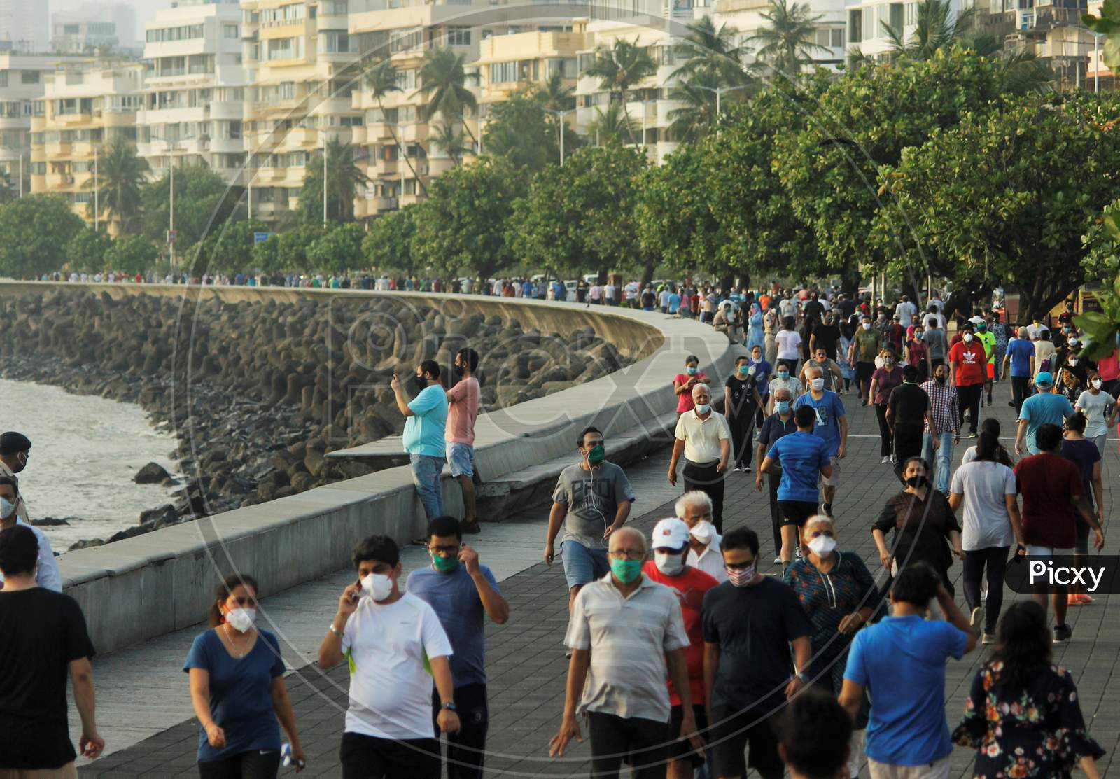 People walk along the promenade at Marine Drive after some restrictions were lifted in Mumbai, India on June 6, 2020.