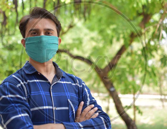 indian student with green mask on face