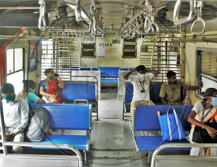 Passengers sit inside the train scheduled for essential service workers after the government eased a nationwide lockdown which was imposed as a preventive measure against the COVID-19 coronavirus, at CST local train station, in Mumbai, India, on June 15, 2020.
