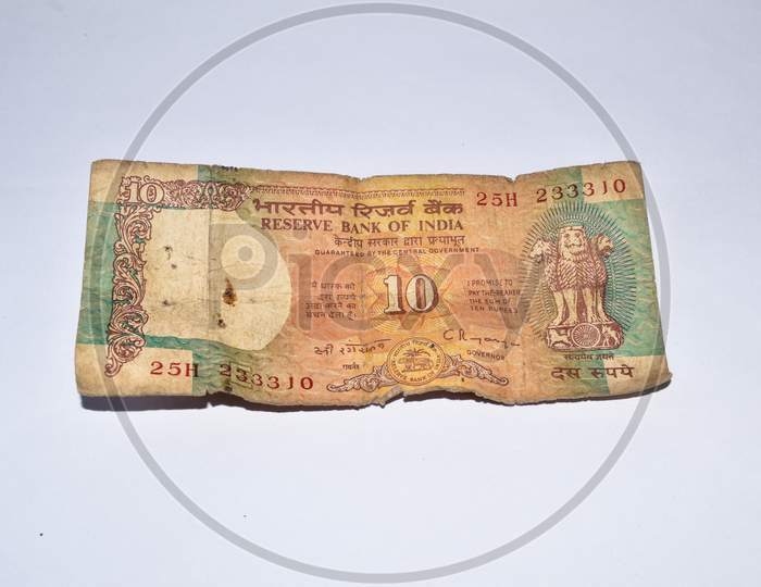 Old 10 Rupees Indian Currency Note On White Background.