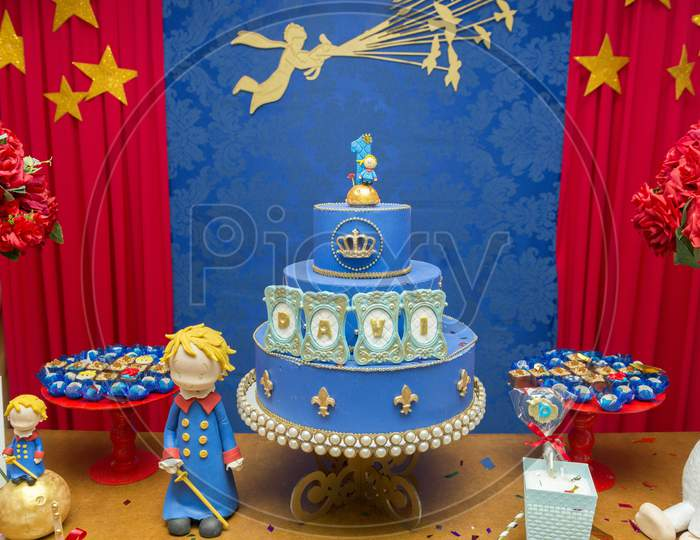 Fake Blue Birthday Cake With A Crown On Top. Little Prince Or Royal Theme. Decorated Table For Child Birthday Celebration. Close Up Of Decor Party.