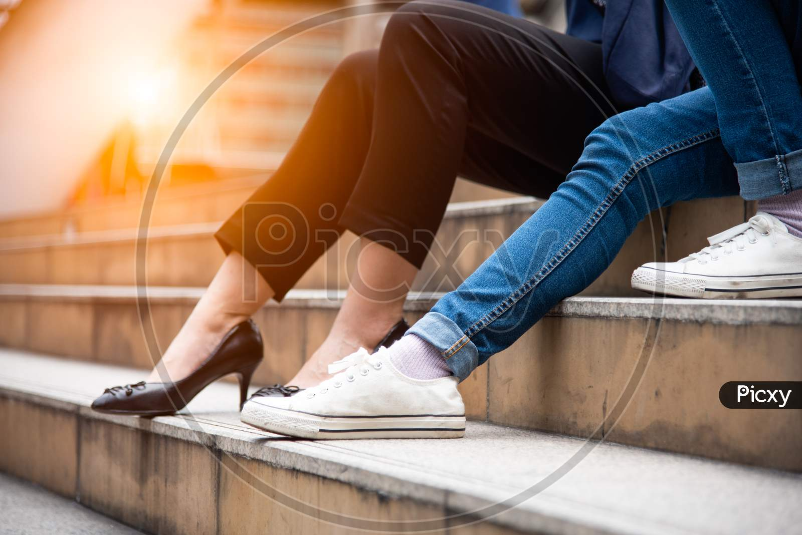 Close Up Of Two Woman Legs. Friend Are Talking Together On Stair. People And Lifestyles Concept. Social And Conversation Concept. Friendship Theme.