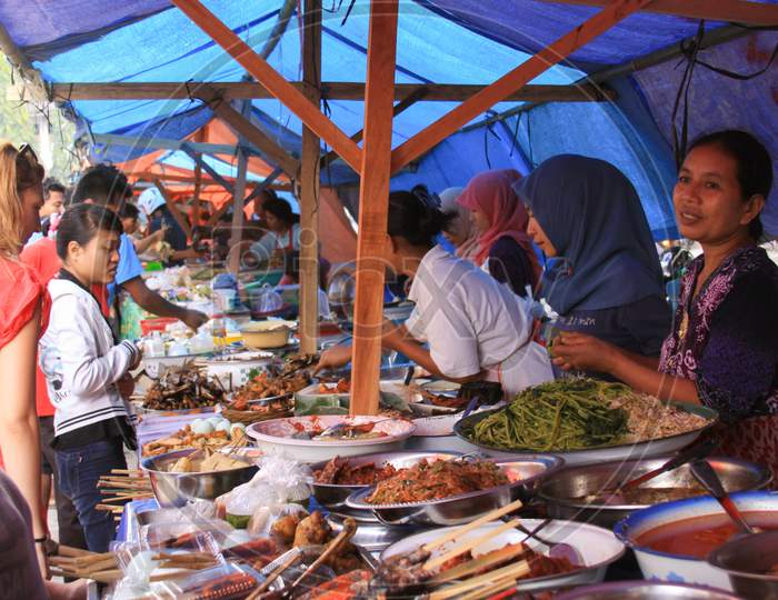 People In Wet Market Selling Goods In Indonesia
