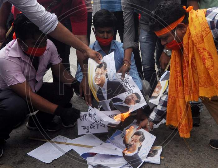 Activists Of Bharat  Raksha Manch Burn A Photo  Of Chinese President Xi Jinping During A Protest Against China Over Galwan Valley Incident, In Guwahati On June 18, 2020.
