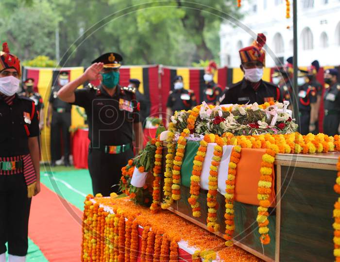 An Indian Army Officer Salutes At The Coffin of N K Deepak Singh, An Indian Soldier Who Was Killed In A Border Clash With Chinese Troops In Ladakh Region, During His Funeral Ceremony at Military Hospital In Prayagraj, June 19, 2020.