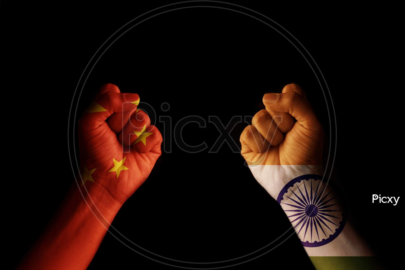 Concept of Dispute or conflict between India and China showing with fist hands