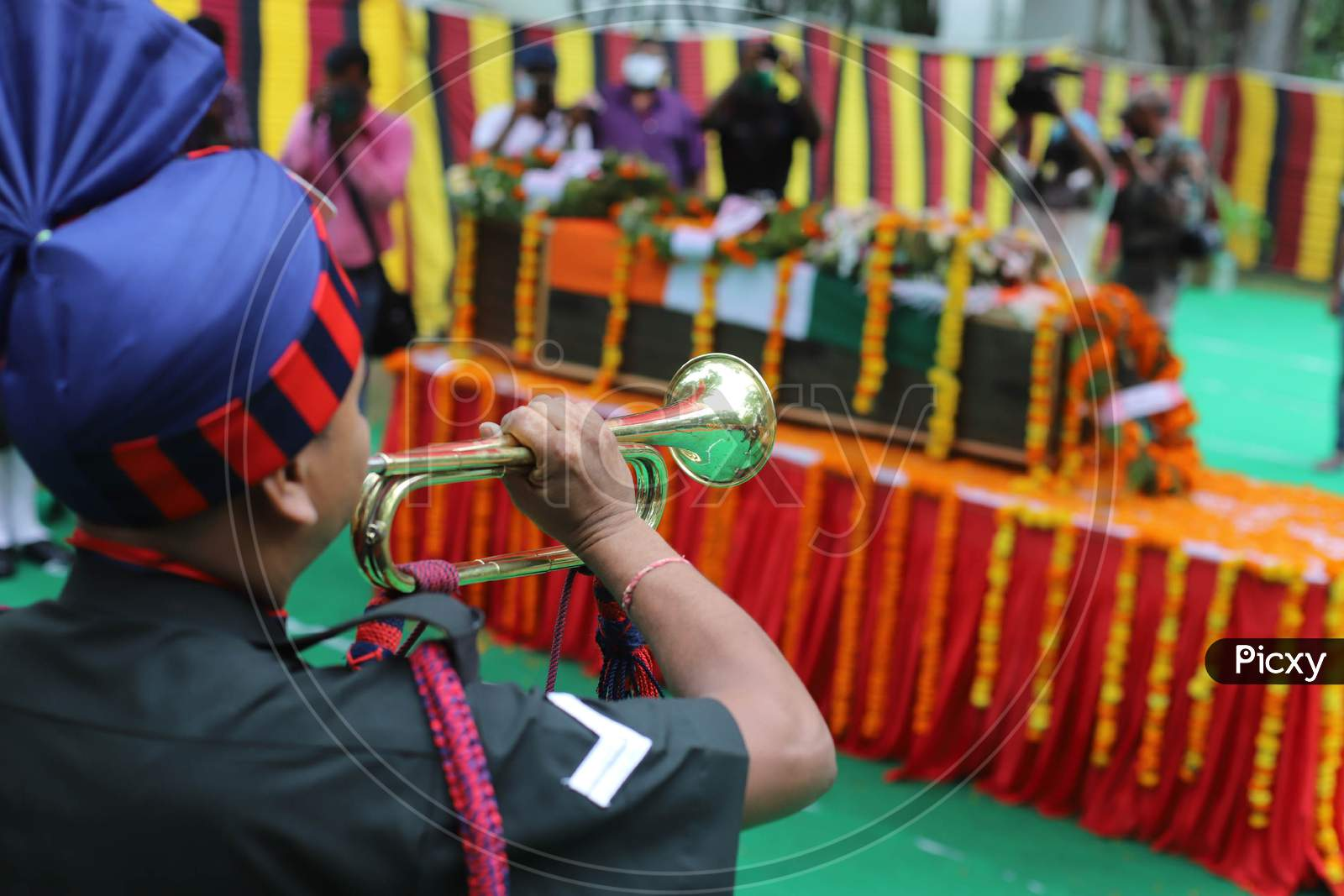 Indian Army Jawans paying official rites at the funeral of  N K Deepak Singh, An Indian Soldier Who Was Killed In A Border Clash With Chinese Troops In Ladakh Region, At Military Hospital In Prayagraj, June 19, 2020.