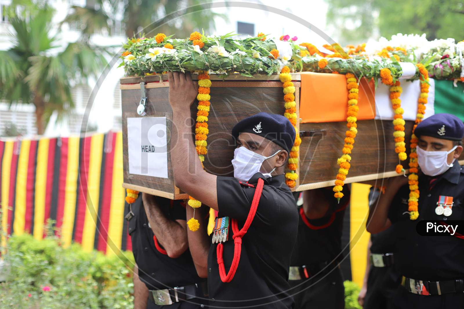 Indian Army Jawans carry the Mortal Remains of N K Deepak Singh, An Indian Soldier Who Was Killed In A Border Clash With Chinese Troops In Ladakh Region, during the funeral ceremony at Military Hospital In Prayagraj, June 19,2020.