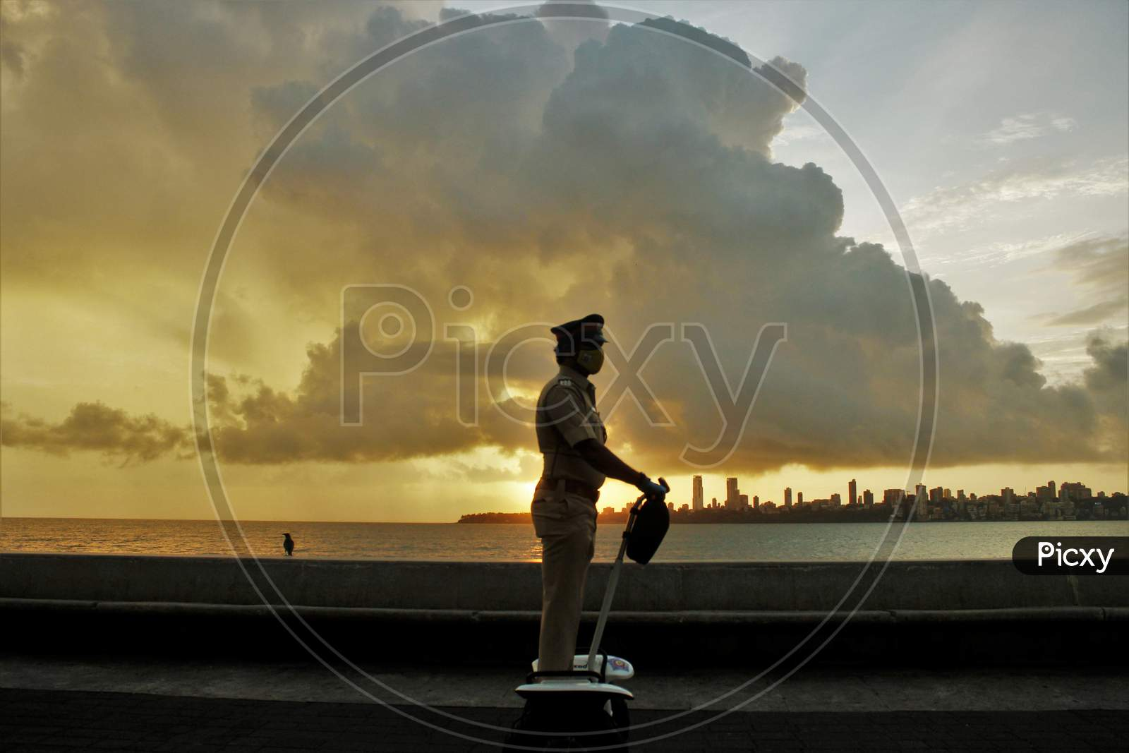 A Mumbai Police official rides a segway at the launch of 'FREEGO self balancing scooter/Segway electric scooter' for police patrolling on sea facing promenades in Mumbai, India on June 11, 2020.