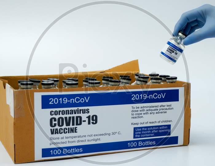 Covid-19 Corona Virus 2019-Ncov Vaccine Vials Medicine Drug Bottles Injection Blue Nitrile Surgical Gloves Box. Vaccination, Immunization, Treatment To Cure Covid 19 Corona Virus Infection Concept.