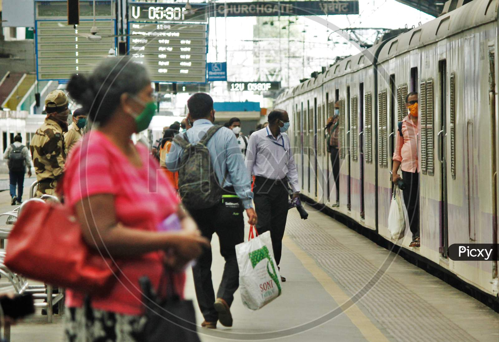 A train carrying essential service workers arrives at a platform, after the government eased a nationwide lockdown that was imposed as a preventive measure against the COVID-19 coronavirus, at Churchgate station, in Mumbai, India, on June 16, 2020.