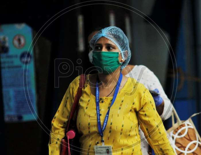 A commuter walks on a platform as she arrives to board a train scheduled for essential service workers, after the government eased a nationwide lockdown that was imposed as a preventive measure against the COVID-19 coronavirus, at Churchgate station, in Mumbai, India, on June 16, 2020.