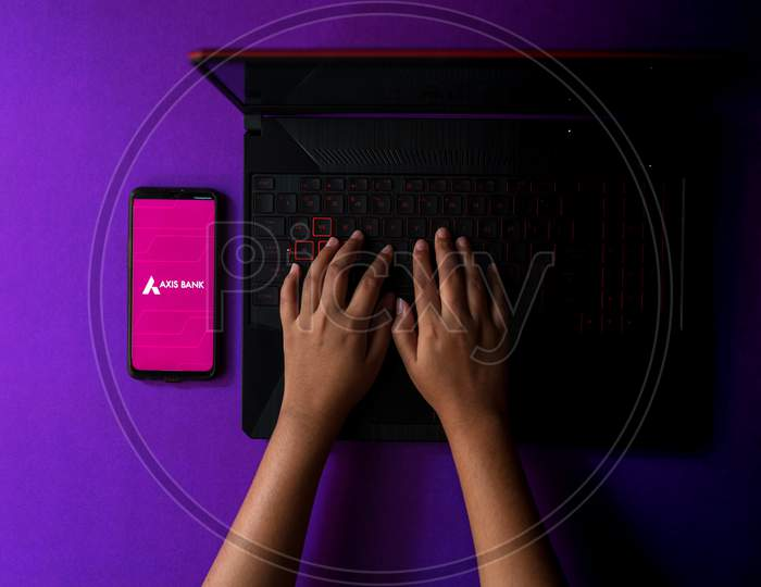 Axis Bank app displayed on a smartphone while working from home