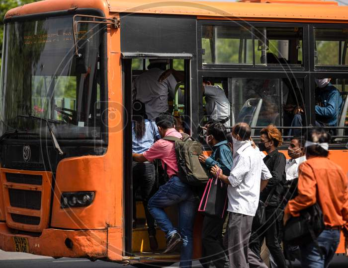 People flout social distancing norms as they board a bus at Anand Vihar, in New Delhi, India On June 23, 2020.