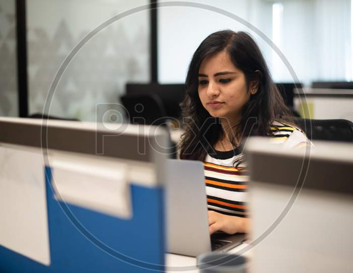 young Indian girl working in an Office.