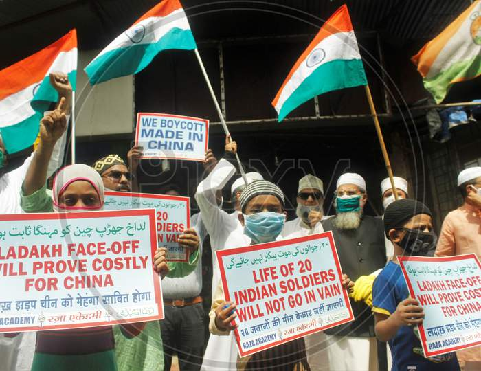 Demonstrators wearing protective masks take part in a protest to condemn the killing of 20 Indian Soldiers over the Ladakh clash with China, in Mumbai, India on June 20, 2020.