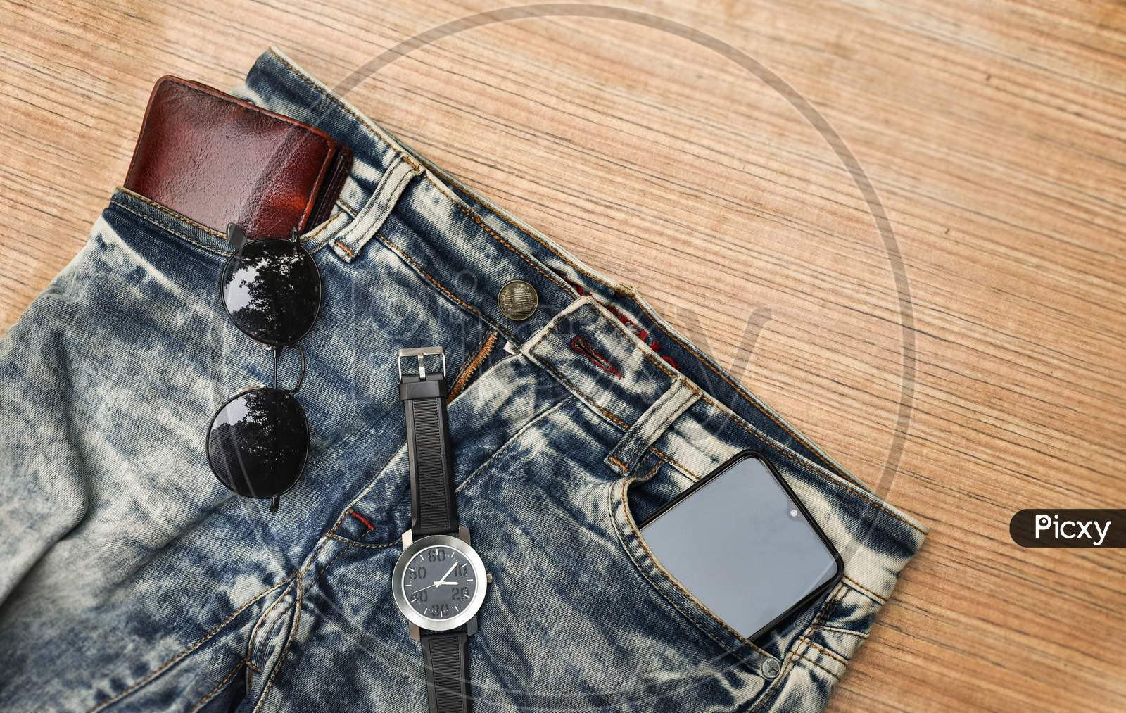 Top View Accessories To Travel With Man Clothing Concept.Telephone,Bow Tie,Passport On Wooden Background.Air Plane,Sunglasses,Headphone,Tree On Wood Table.Flat Lay.Copy Space.Music Listening.