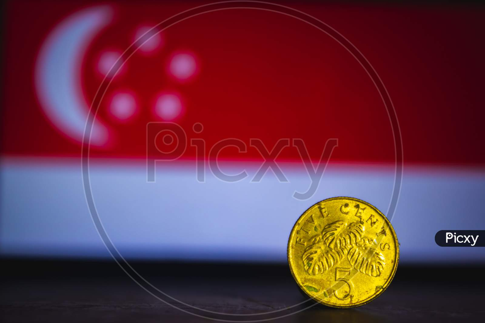 Singapore Currency - Five Cent Coin Of Singapore Isolated On Singapore Flag Background. Singapore Dollar 5 Cent Coin With Space For Text Copy