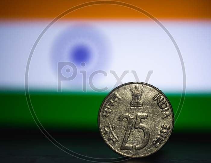Indian Currency - Indian Twenty Paisa Coin Rupee Isolated On India Flag Background. Old 25 Paisa Coin 1979 With Space For Copy Text.